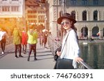 young female traveler in front... | Shutterstock . vector #746760391