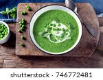 green pea soup on wooden... | Shutterstock . vector #746772481