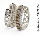 white gold diamond earings on... | Shutterstock . vector #74677936