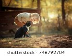 Stock photo sweet baby with a forest with a cat 746792704