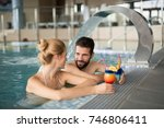 cheerful happy couple relaxing... | Shutterstock . vector #746806411