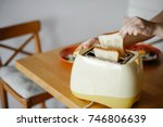 yellow toaster with toasted...   Shutterstock . vector #746806639