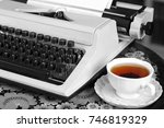 a typewriter and tea. old... | Shutterstock . vector #746819329