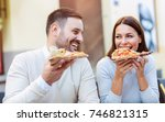 couple eating pizza snack...   Shutterstock . vector #746821315