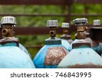 old gas cylinders outdoors