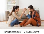 family  parenthood and people... | Shutterstock . vector #746882095
