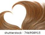 hair in shape of heart on white | Shutterstock . vector #746908915