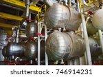 heat exchangers in a refinery.... | Shutterstock . vector #746914231
