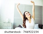 young brunette woman stretches... | Shutterstock . vector #746922154