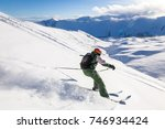 skiing in the snowy mountains ... | Shutterstock . vector #746934424