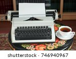 a typewriter and tea on an... | Shutterstock . vector #746940967