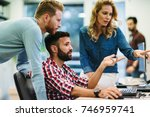 software engineers working on... | Shutterstock . vector #746959741