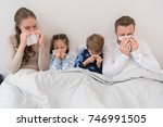 sick parents ans children lying ... | Shutterstock . vector #746991505