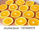 oranges are cut into slices and ... | Shutterstock . vector #747000979