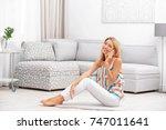 beautiful young woman talking... | Shutterstock . vector #747011641