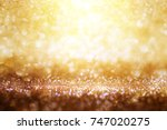 golden glitter background with... | Shutterstock . vector #747020275