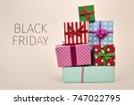 a pile of gifts wrapped in... | Shutterstock . vector #747022795