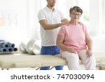 personal masseur massaging... | Shutterstock . vector #747030094