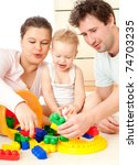 young  happy family in a room... | Shutterstock . vector #74703235
