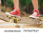 cute girl climbing in adventure ... | Shutterstock . vector #747037927