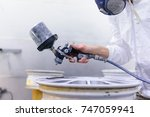 a varnisher is painting an... | Shutterstock . vector #747059941