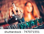 close up of barmaid hand... | Shutterstock . vector #747071551