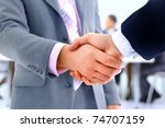 handshake isolated on business... | Shutterstock . vector #74707159