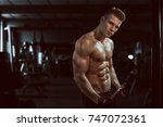 man sports in the gym.guy in... | Shutterstock . vector #747072361