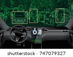 self driving car on a road.... | Shutterstock . vector #747079327