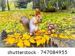 squirrel with nuts in autumn... | Shutterstock . vector #747084955