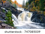 Small photo of Autumn mountain forest waterfall river in Karelia, Russia