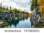 autumn mountain forest river in ... | Shutterstock . vector #747085051