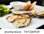 baked mussels au gratin with... | Shutterstock . vector #747100939