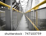 yellow railing of a... | Shutterstock . vector #747103759