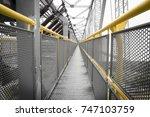 yellow railing of a... | Shutterstock . vector #747103759