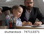 man and kid sit at desk with... | Shutterstock . vector #747113371
