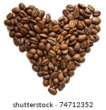 Heart symbol made from coffee beans isolated on white - stock photo