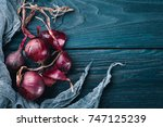 ripe onion. on a wooden...