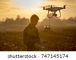 attractive farmer navigating... | Shutterstock . vector #747145174