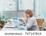 young woman in the office... | Shutterstock . vector #747147814