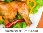 roasted chicken ham garnished with fresh green salad, pepper and greens - stock photo