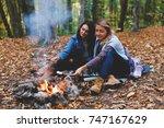 two young girls girlfriends... | Shutterstock . vector #747167629