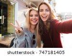 two joyful attractive girls... | Shutterstock . vector #747181405
