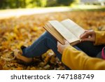 the woman in yellow coat and... | Shutterstock . vector #747188749