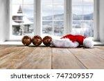 desk and winter window  | Shutterstock . vector #747209557