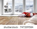 desk and winter window  | Shutterstock . vector #747209584