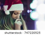 sad woman by the christmas tree ... | Shutterstock . vector #747220525