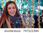 beautiful young woman mittens... | Shutterstock . vector #747221584