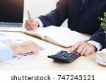 male accountant calculating tax ... | Shutterstock . vector #747243121