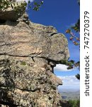 Small photo of Near the top of Kokshetau, unusual rocks, which create a face of somebody with a hat.